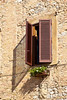 Window shutters and shadows, San Gimignano, Tuscany, Italy