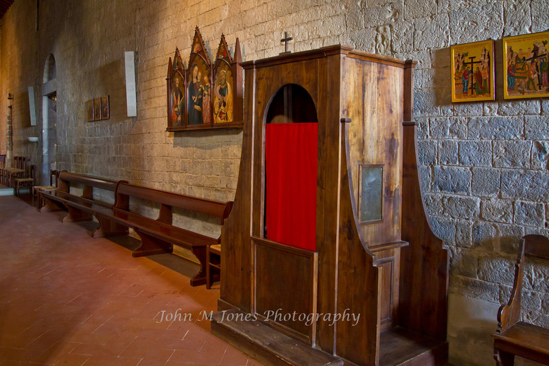 Confessional in Pieve di San Leonlina, a small Romanesque church near Panzano, Tuscany, Italy