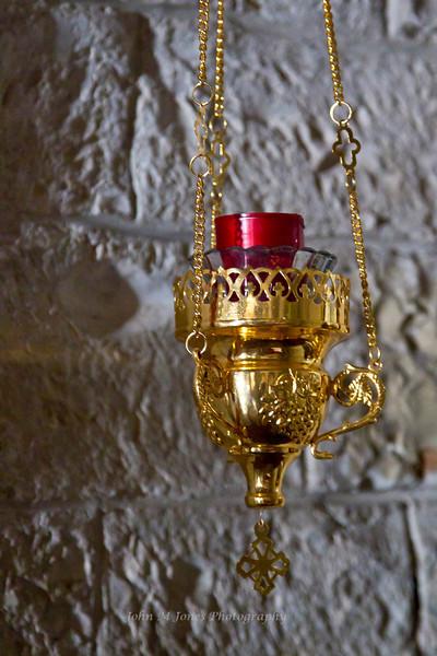 Candle in Pieve di San Leonlina, a small Romanesque church near Panzano, Tuscany, Italy