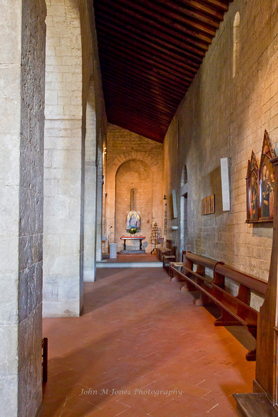 Side aisle in Pieve di San Leonlina, a small Romanesque church near Panzano, Tuscany, Italy