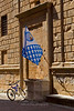 Flag and bike in Pienza, Siena, Tuscany, Italy
