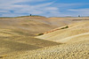 Plowed fields in the rolling farmland of Tuscany's Val d'Orcia, Siena, Italy
