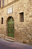 Old wall and green doors, San Gimignano, Tuscany, Italy