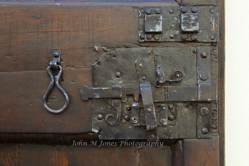 Ancient door latch in Radda, Chianti region of Tuscany, Italy