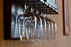 Wine glasses in rack, Vignamaggio winery, Chianti region, Tuscany, Italy