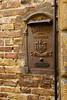 Old postal box, San Gimignano, Tuscany, Italy