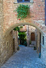 Arched narrow street in Montefioralle, Tuscany, Italy