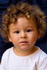 Curly-haired child in Montefioralle, Tuscany, Italy