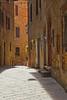 Narrow street in Pienza, Siena, Tuscany, Italy