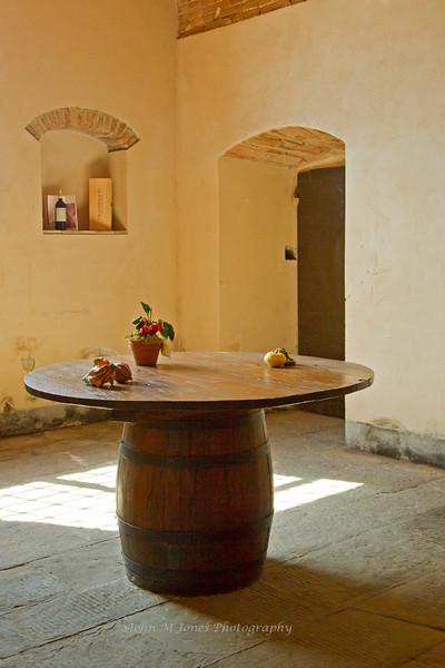 Old wine barrel table with display, Vignamaggio winery, Chianti region, Tuscany, Italy