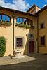 Courtyard and well, Vignamaggio winery, Chianti region, Tuscany, Italy