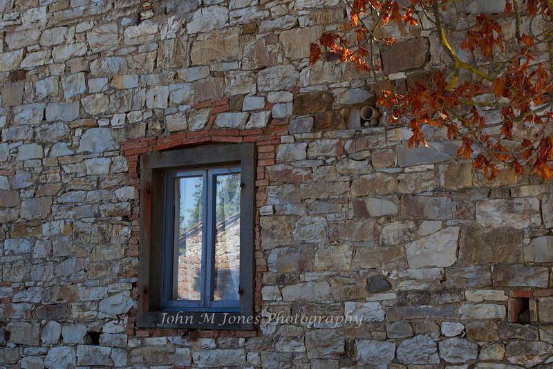 Window reflection, villa near Radda, Chianti region of Tuscany, Italy