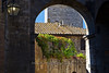 View of garden through archway, San Gimignano, Tuscany, Italy