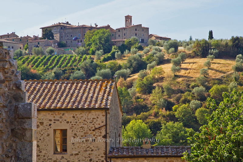 View of hill town Castelnuovo dell'Abate from Sant' Antimo Abbey, near Siena, Tuscany, Italy