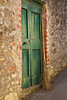 Broom leaning against a green door, Greve, Tuscany Italy