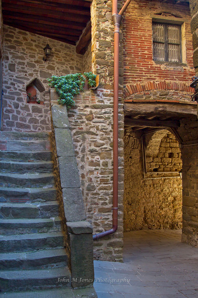 Stone steps worn through centuries of use, Castell di Volpaia, Chianti region of Tuscany, Italy