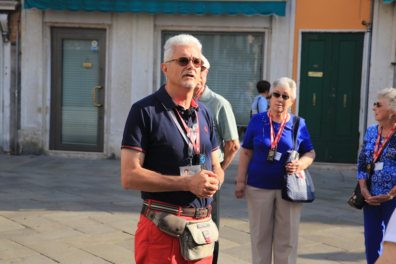 Local tour guide  explains the history of Venice.