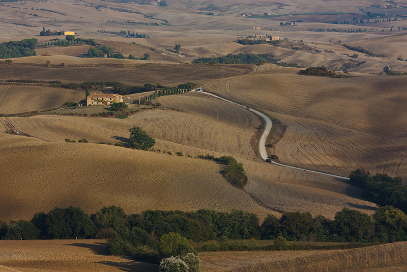 "The light was beautiful as we drove back to San Quirico. The Val d'Orcia landscape changes seasonally, from the lush greens of spring, to the brown hues of fall when the summer wheat has been harvested and the heavy clay soils have been plowed in preparation for planting the winter wheat crop. The area has a special designation as the ""Parco artistico, naturale e culturale della Val d'Orcia,"" with the goal of preserving the extraordinary artistic and natural heritage of the five municipalities which constitute it: Castiglione d'Orcia, Montalcino, San Quirico d'Orcia, Radicofani and Pienza."