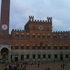 "The Piazza del Campo (where ""Il Palio"" is raced) in front of Palazzo Pubblico"