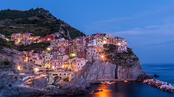 The town of Manarola on the Cinque Terre coast of the Mediterranean in early evening