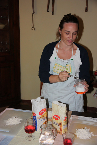 The class was taught by Katia and her uncle Fulvio and we were joined by two other couples, both British. First we made pasta dough, . . .