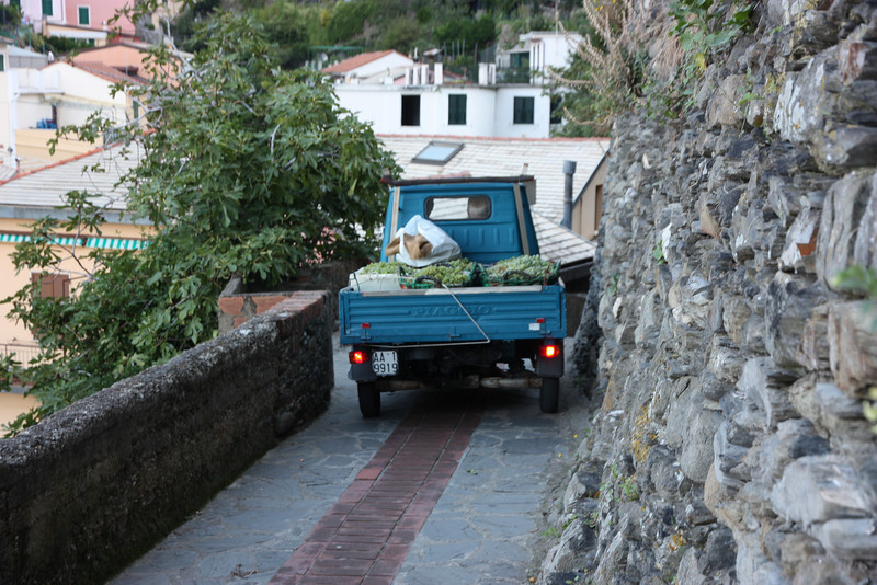 "or by Ape (that's ""Ahpay""), the ubiquitous three wheeled-vehicle which is the Subaru of Tuscany . . ."
