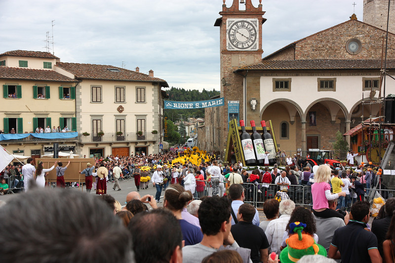 The parade wound through the city square to the delight of hundreds of spectators . . .