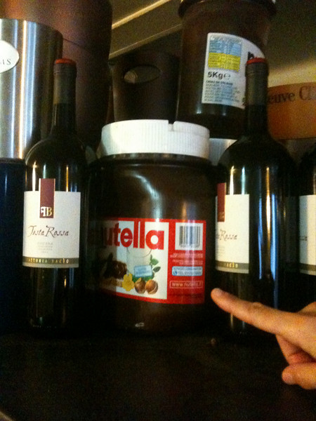 The Italian cafe essentials:  Nutella in 5 kilo containers, stored next to giant bottles of house red wine.