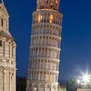 Pisa, Italy - July 27, 2013: Tourists visiting Leaning Tower in Pisa in summer holiday. This is one of most touristic landmarks of Tuscany and Italy. Campanile of the Cathedral was built in romanesque architecture in the XIIth century.