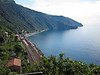 On our second day in Cinque Terre we took the train up the coast to Corniglia. We had planned to take the trail along the water, but recent heavy rain had caused landslides and the trail was closed. The train travels mostly through tunnels along the coastline, emerging at each town. You can see Manarola on the first point of land in the distance.