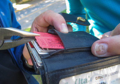 The Leatherman proves its worth by extracting tickets from wallet.
