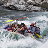 "Our raft, nearly invisible in the water! Photo shot by Glacier Raft Co. photographer. On ""Picture Rapid"" I think?"