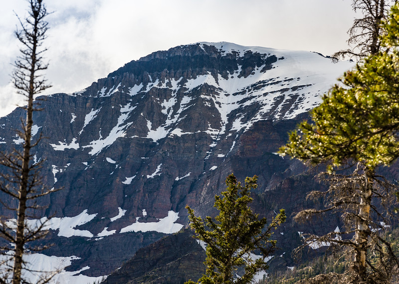 Snow-covered mountain above Two Medicine Lake
