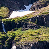 Waterfall from snowfield above Two Medicine Lake