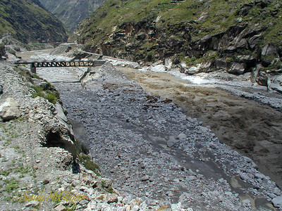 Here is a closeup photo of the trestle bridge at Wangtoo, showing the channel under the bridge silted up and the approach ramp to the right of the bridge now missing. The road along the right bank has been destroyed along this stretch of river. This photo was taken after the June 2000 flood, but before the August 1, 2000, flood.