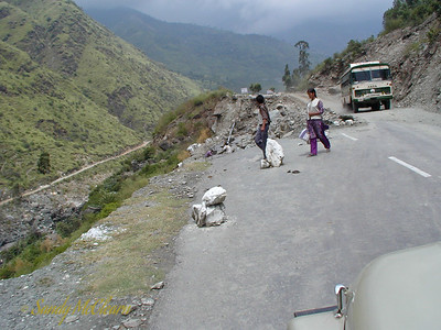 A section of road in the same area as the previous photo where a slide has taken out a portion of the road, and a single lane section has been reinstated to allow traffic to pass. These roads are near Rampur.