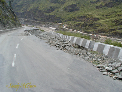 More damage to NH 22 near Rampur. Because of the sheer amount of material removed from the slope below the road, repairing this damage became quite difficult.