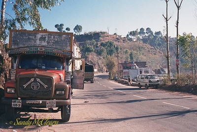 A fairly typical transport truck for the Himalayan region of India. Many drivers decorate their trucks to the hilt, including the windshield, so at least this driver can see out. This photo was taken on the road between Chandigarh and Shimla, as we started to head into the mountains.