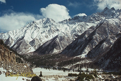 "This photo was taken in the Sangla Valley, a few hours to the east of Ponda Camp and then south from the Satluj River Valley. On the map, find Point ""J"" and go slightly east, then follow the first major valley to the south and you should see Sangla on the map. Sangla was a minor tourist destination in this region, and a number of us took a day trip there in the first few months of my time in India. This photo was probably taken in March or April, 1999."