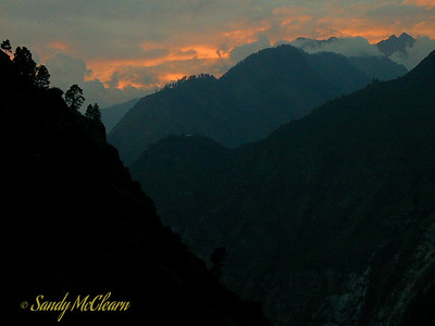 This photograph looks towards the sunset in the west, downstream along the Satluj River valley, from Ponda Camp.