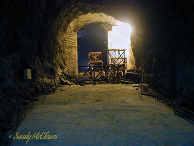 The inside of the outlet tunnel from Desilting Chamber #4, looking in the opposite direction from the previous photo. The support towers and the ski jump concrete form for the overt pour are sitting in the tunnel waiting for installation. The HRT is behind the photographer in this photo.
