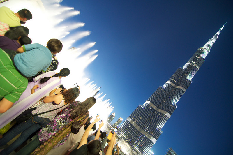 "Evening water works show at the Dubai Mall.  <a href=""http://www.burjkhalifa.ae/"">Burj Khalifa</a> in the background."
