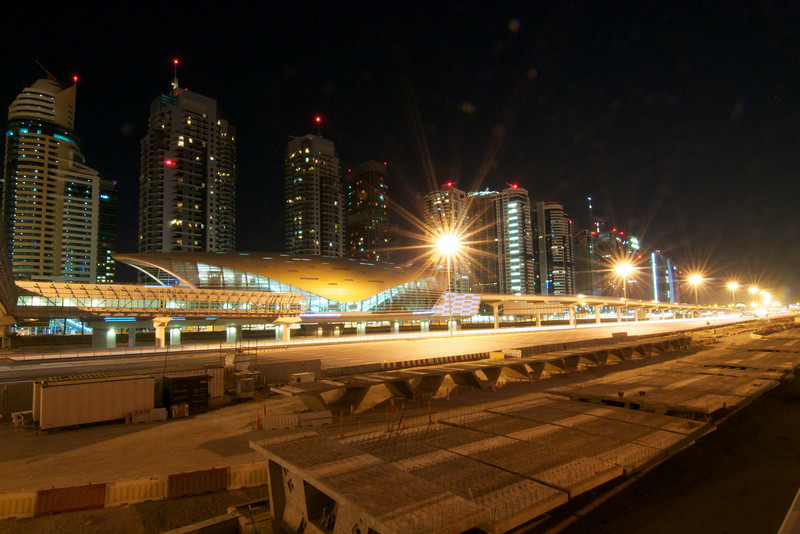 Dubai's new metro system (some 72 kilometers completed in six years) running along the main highway in the Marina area.