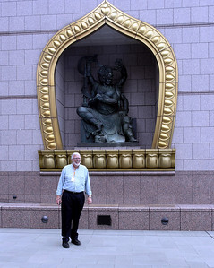 Dean Van Alfen in front of Chung Tai Chan Monastery sculpture.