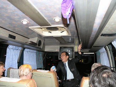 Dr. Chang-Hsien Yang, Director of the NCHU Biotechnology Center greets delegation on the way from the airport to Taichung on Saturday evening.