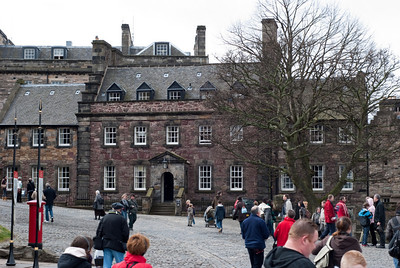 People milling about the castle buildings and exhibits