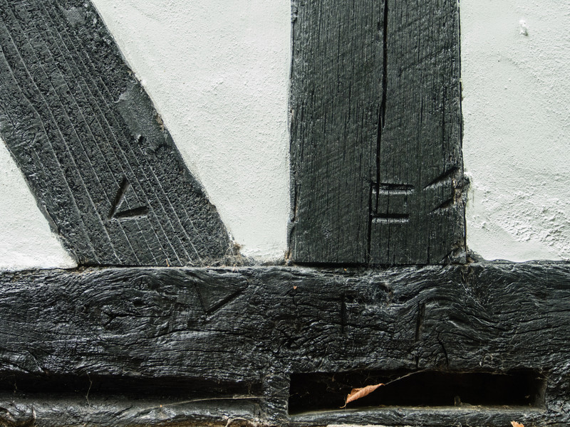 Builder's Marks on the Timbers (the original prefab house)