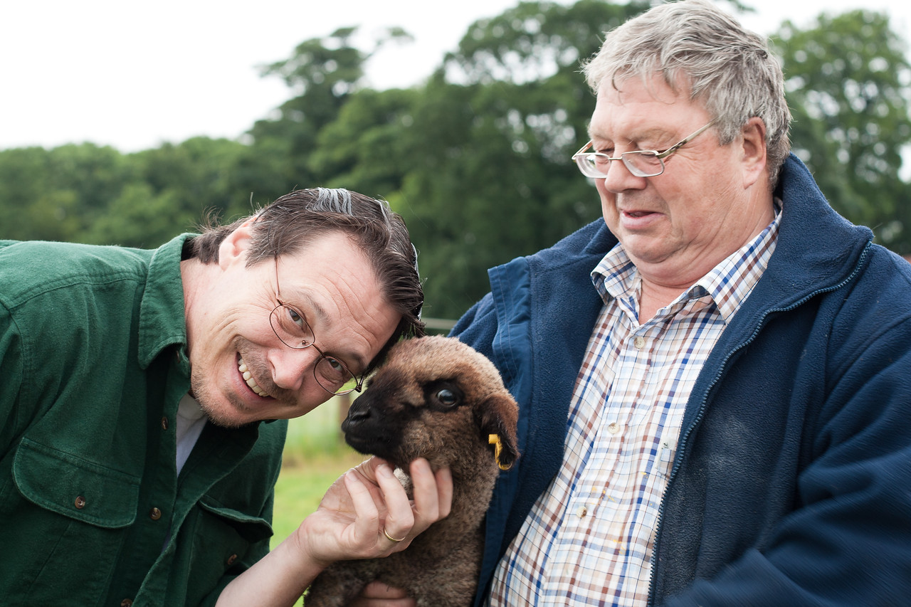 4 July 2012: Pete, our host at The Old Rectory Farm, holding a lamb for Patrick.