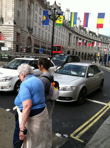 28 June 2012: Here we are, waiting to cross the road. I believe all these flags are up for the Olympics.