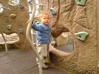 James at a climbing wall in a playground in Bakewell